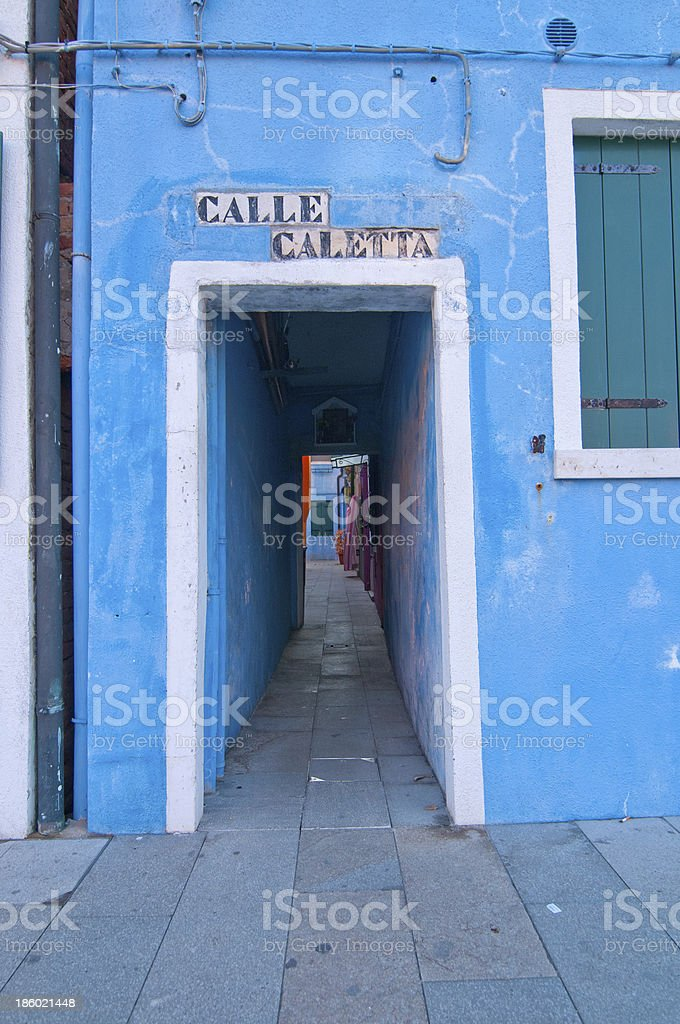 Colourful blue walled house and doorway in Venice, Italy royalty-free stock photo