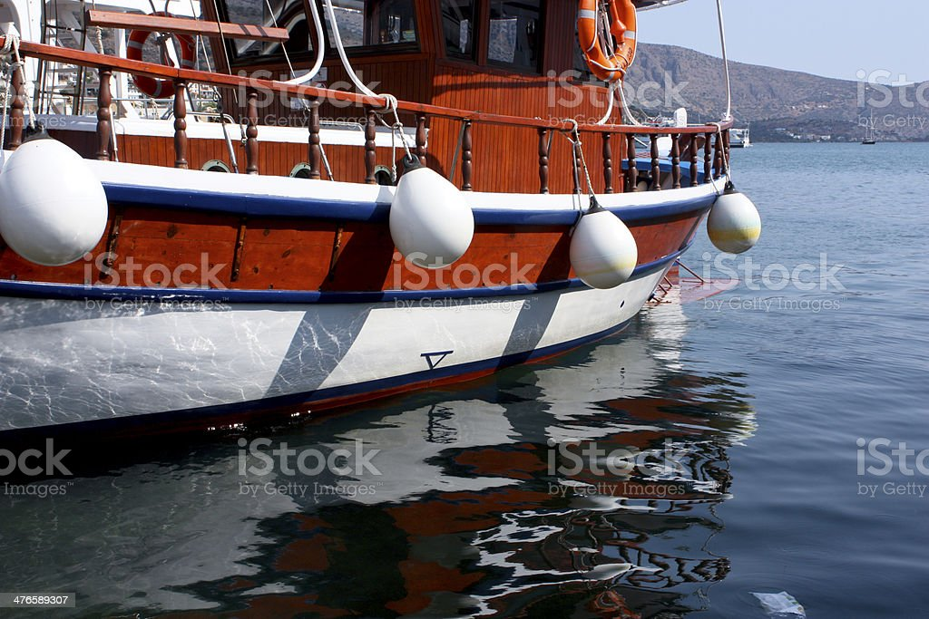 Colourful Boat Reflected in Blue Water royalty-free stock photo