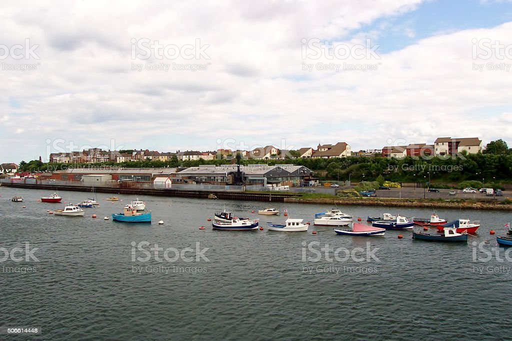 Colourful boats on swinging moorings in Newcastle, UK stock photo