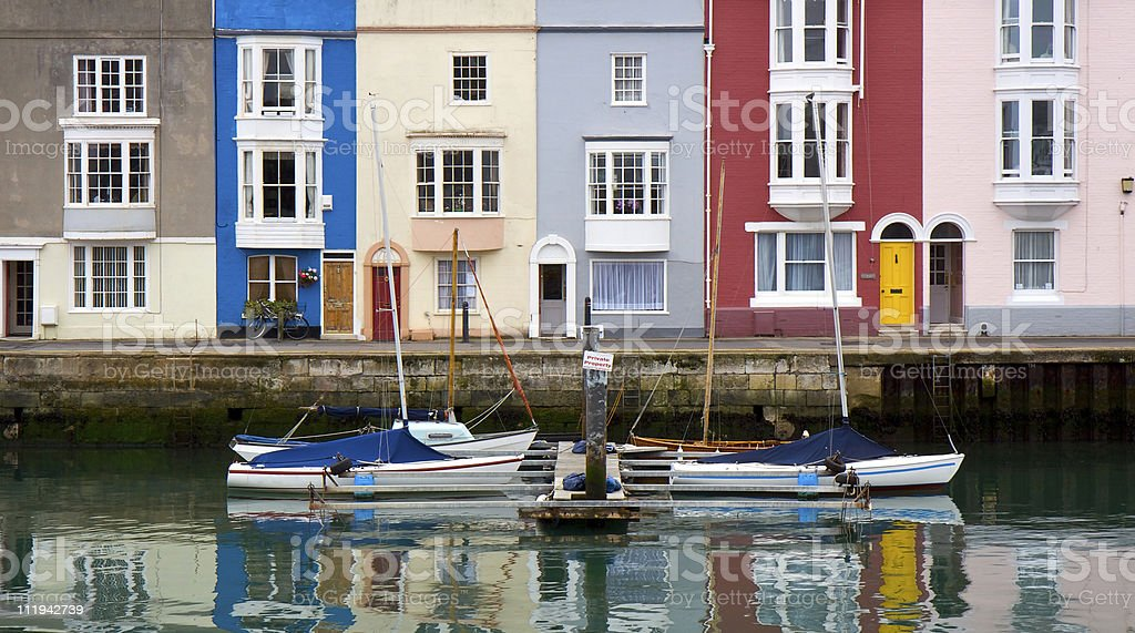 Colourful buildings and boats in Weymouth Harbour stock photo
