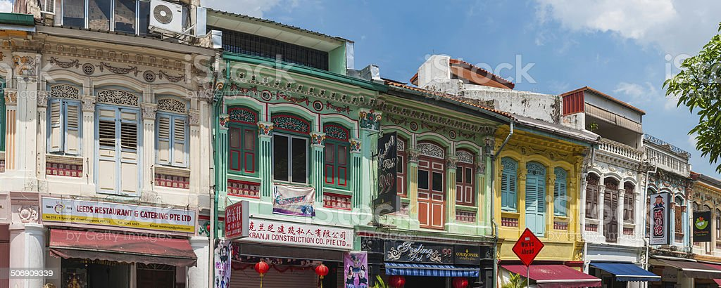Colourful buildings shop and shutters panorama Little India Singapore stock photo