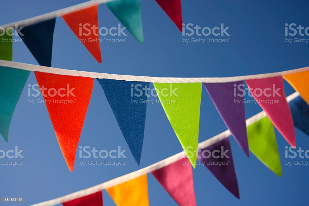 Colourful bunting against blue summer sky stock photo