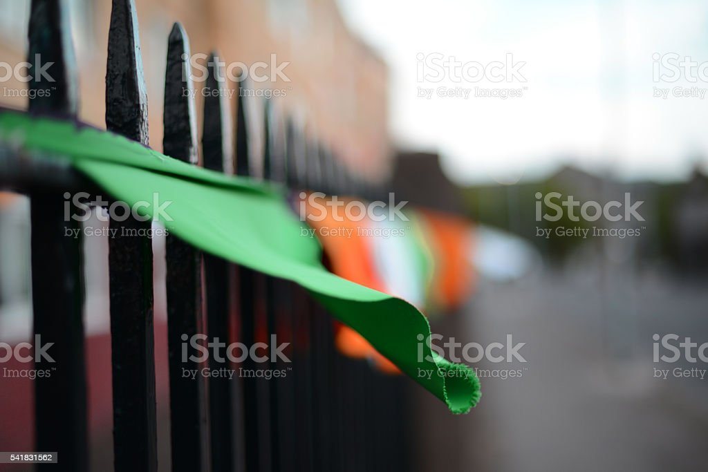 Colourful bunting flags on railing stock photo