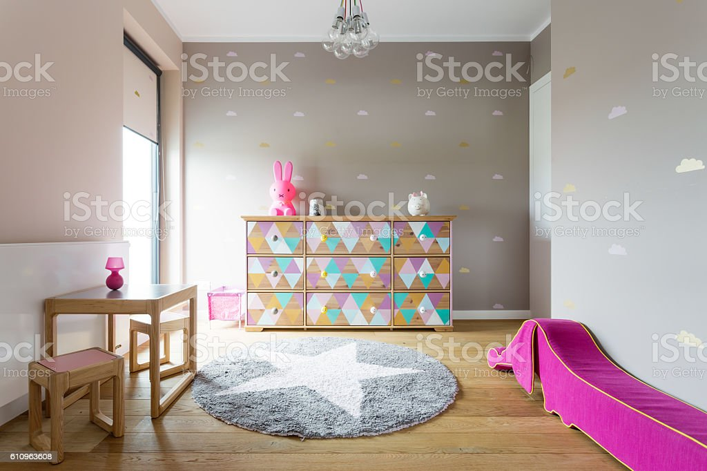 Colourful but stylish decor of a girl's room stock photo