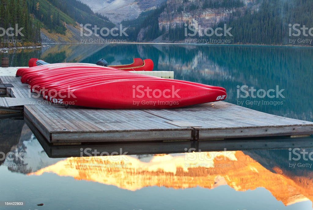 Colourful Canoes and Mountain Lake stock photo