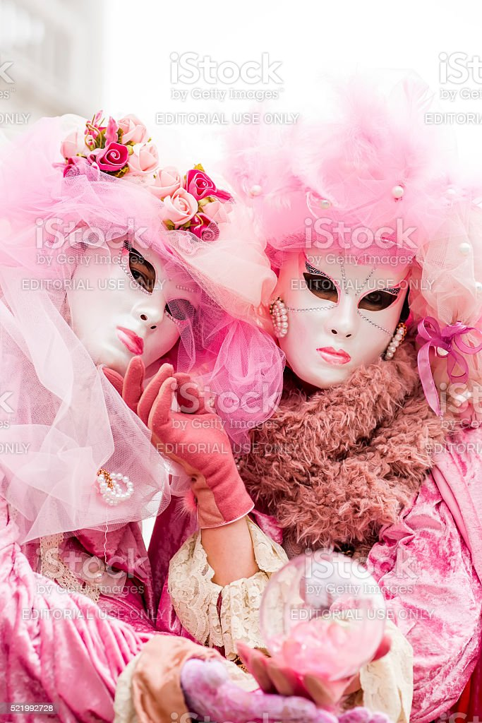 Colourful carnival woman mask in Venice, Italy stock photo