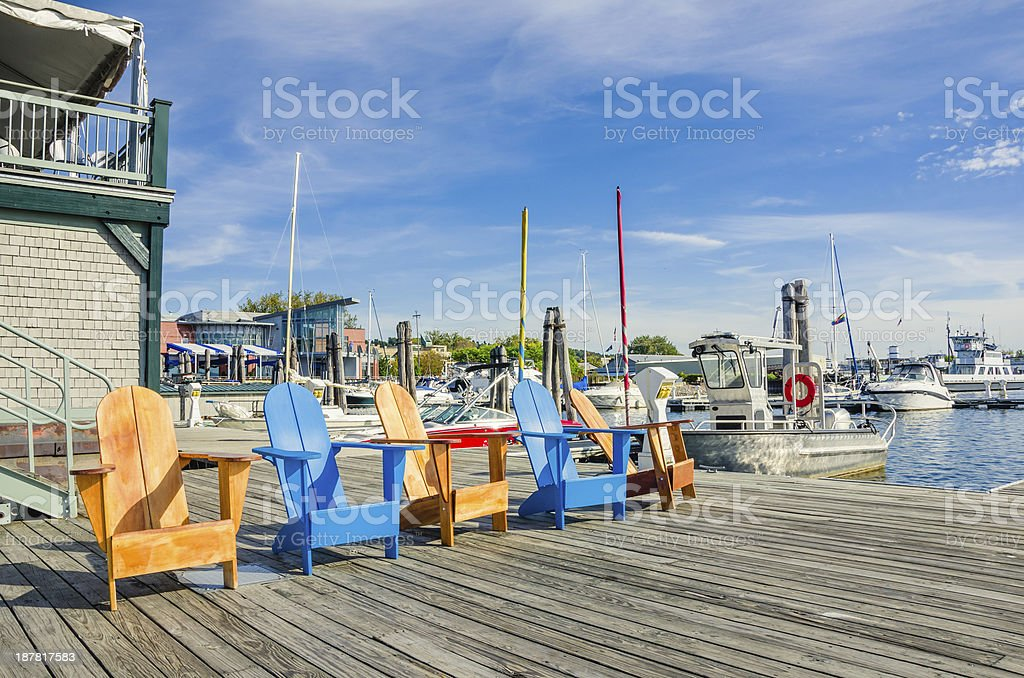 Colourful Chairs on a Jetty at Sunset stock photo
