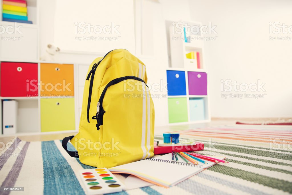 Colourful children rooom with white walls and furniture stock photo