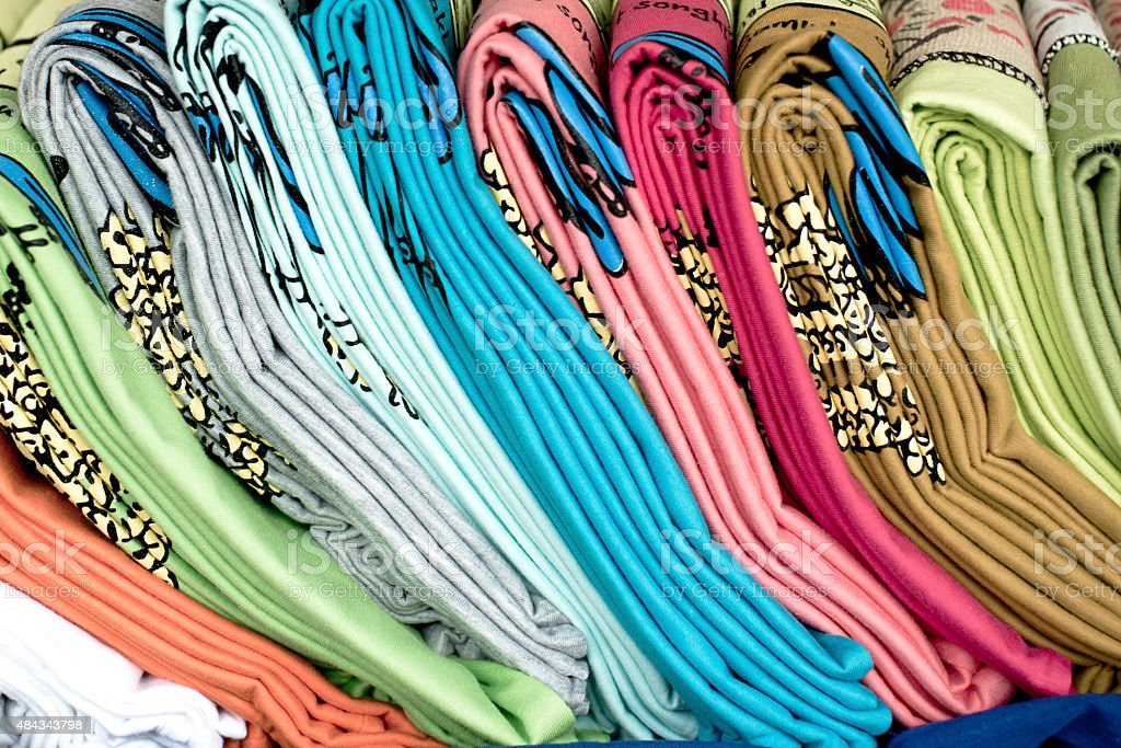 Colourful clothes stacked in a retail store royalty-free stock photo