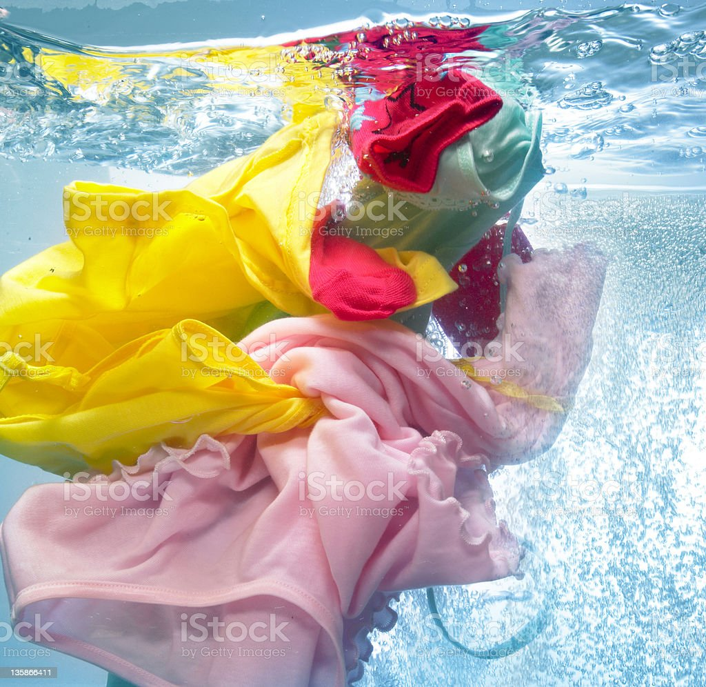 Colourful clothing in the wash stock photo