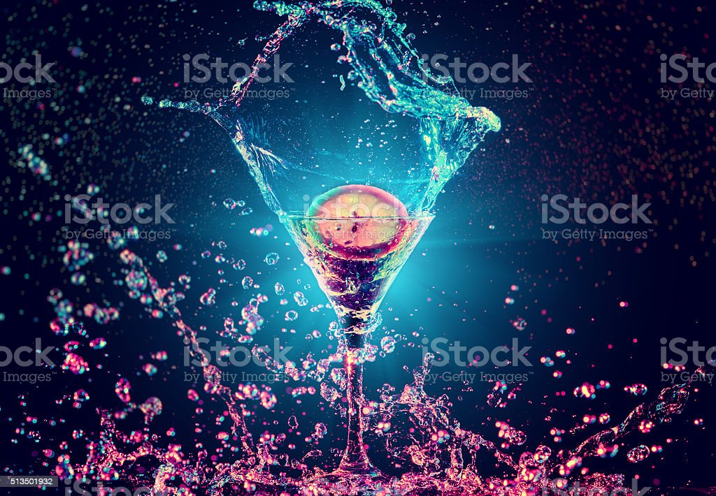 Colourful cocktail in glass with splash stock photo