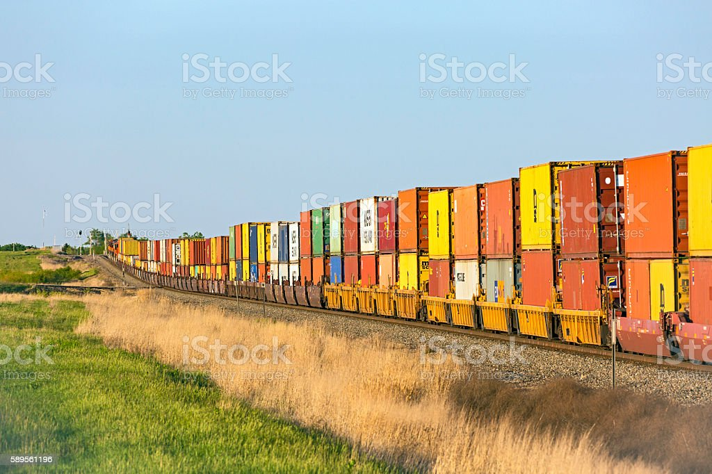 Colourful container stack train with blue sky stock photo