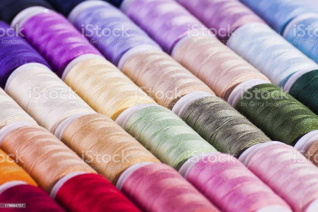 Colourful cotton reels for background royalty-free stock photo