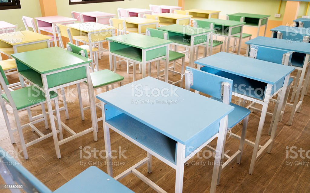 colourful desk in class room stock photo