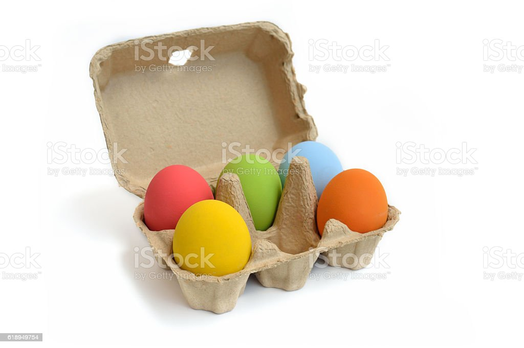 Colourful Easter eggs in the carton box. stock photo