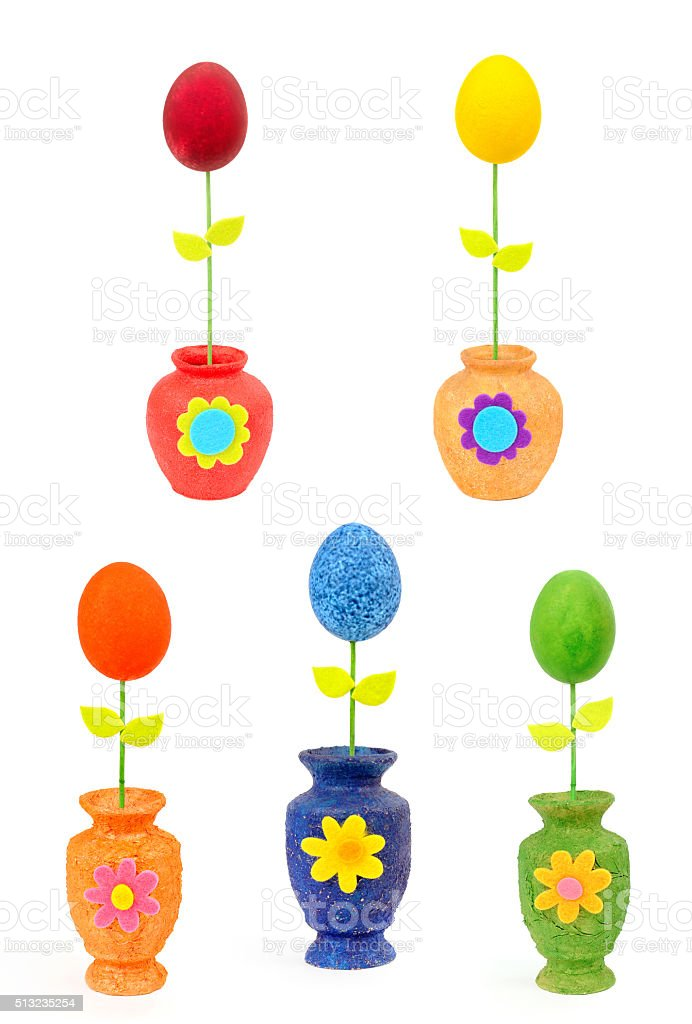 Colourful Easter eggs in vases. Isolated on the white stock photo