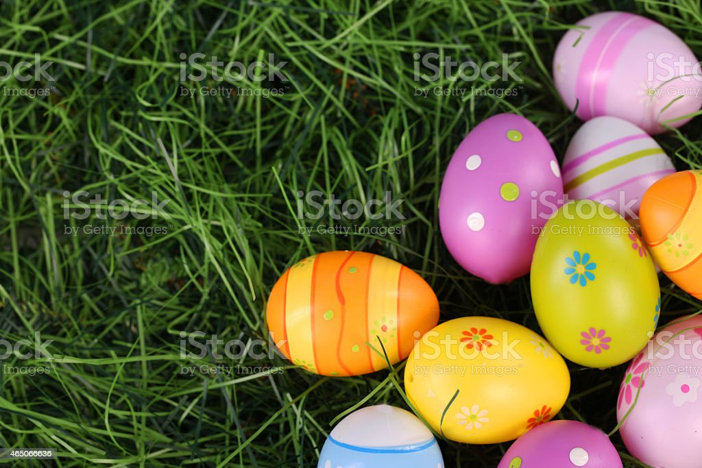Colourful easter eggs on grass stock photo