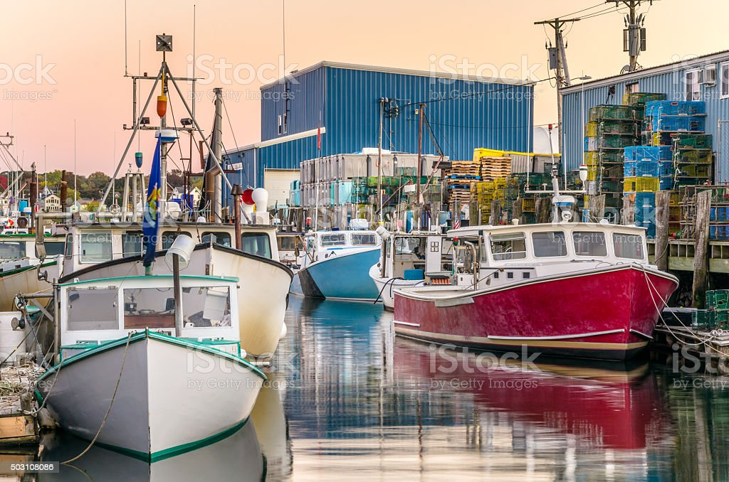 Colourful Fishing Boats at Dusk stock photo