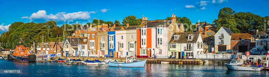 Colourful fishing village boats summer harbour panorama Weymouth Dorset UK stock photo