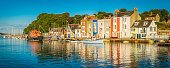 Colourful fishing village homes on tranquil summer harbour Weymouth Dorset