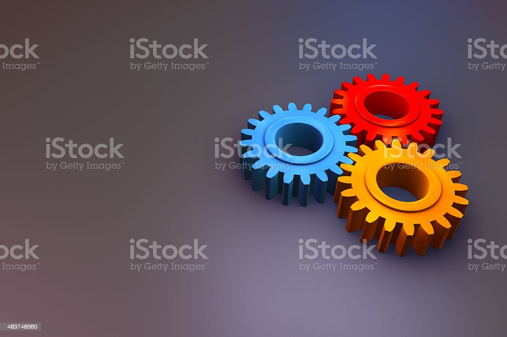 colourful gears on dark background stock photo
