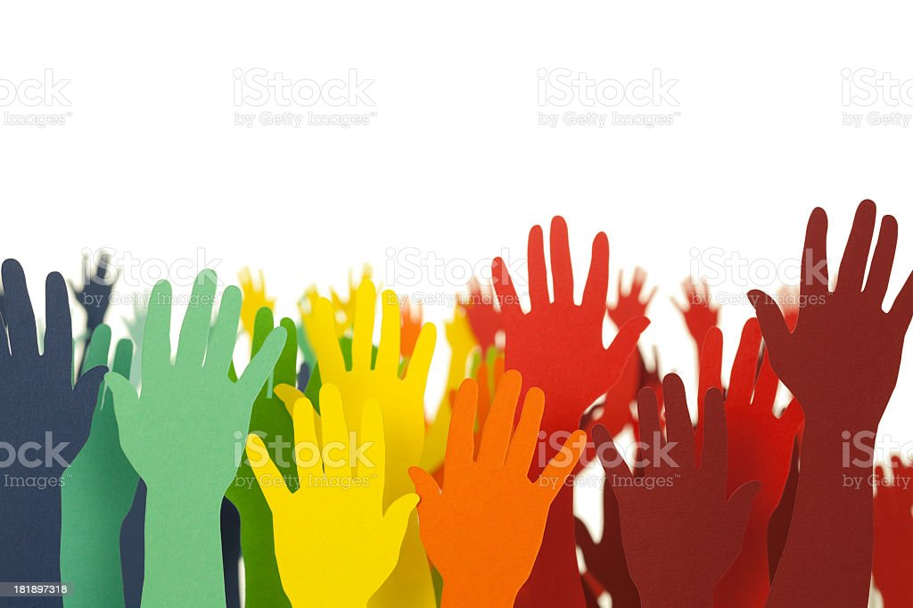 Colourful hands up in the air stock photo