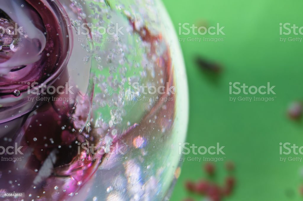 colourful healing sphere close up macro on green background abstract stock photo