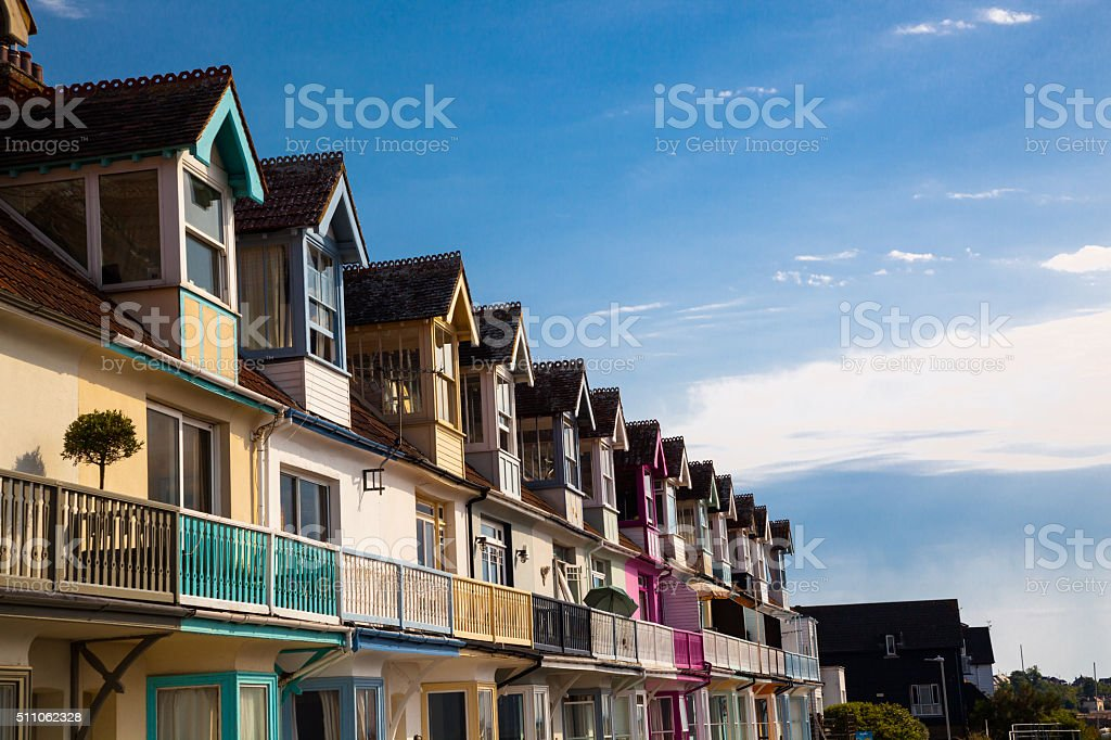colourful holiday seaside apartments in summer sun england stock photo