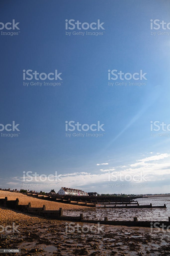 colourful holiday seaside apartments on beach in summer sun england stock photo