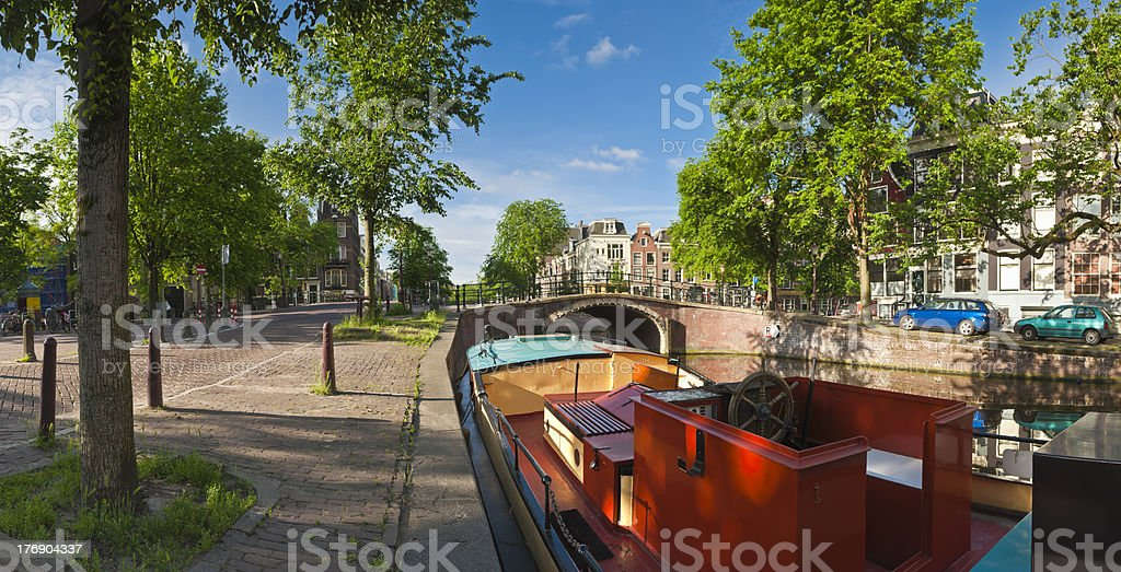Colourful houseboat on Amsterdam canal stock photo