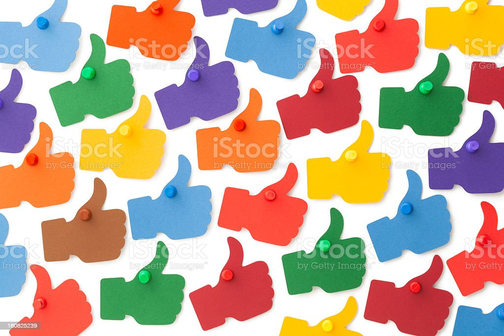 Colourful I LIKE thumbs up pinned to white surface royalty-free stock photo