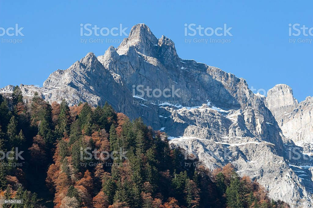 Colourful Indian Summer Forest and Glaernisch Massiv Central Alps, Switzerland stock photo