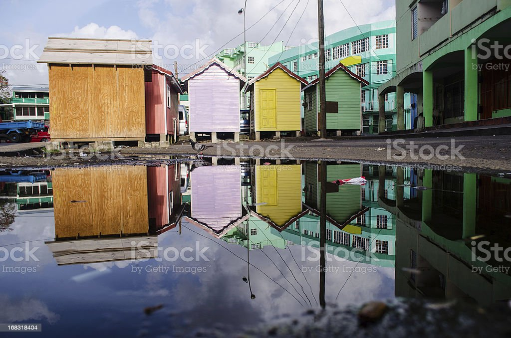 colourful kiosks reflected in city puddle stock photo