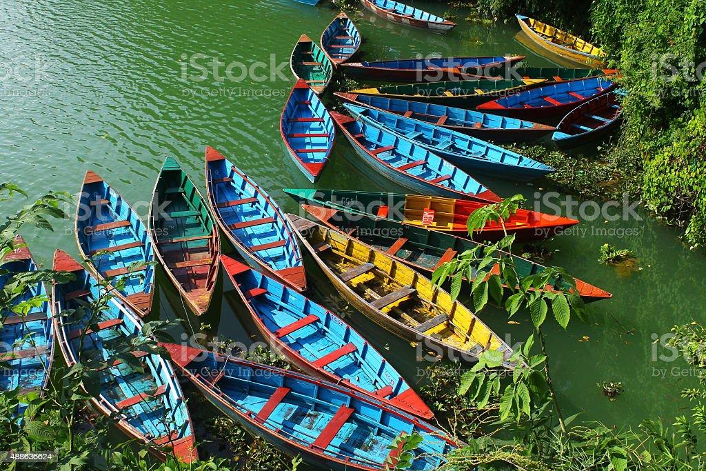 Colourful Lake Boats at Pokhara, Nepal stock photo