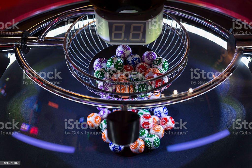 Colourful lottery balls in a lotto machine stock photo