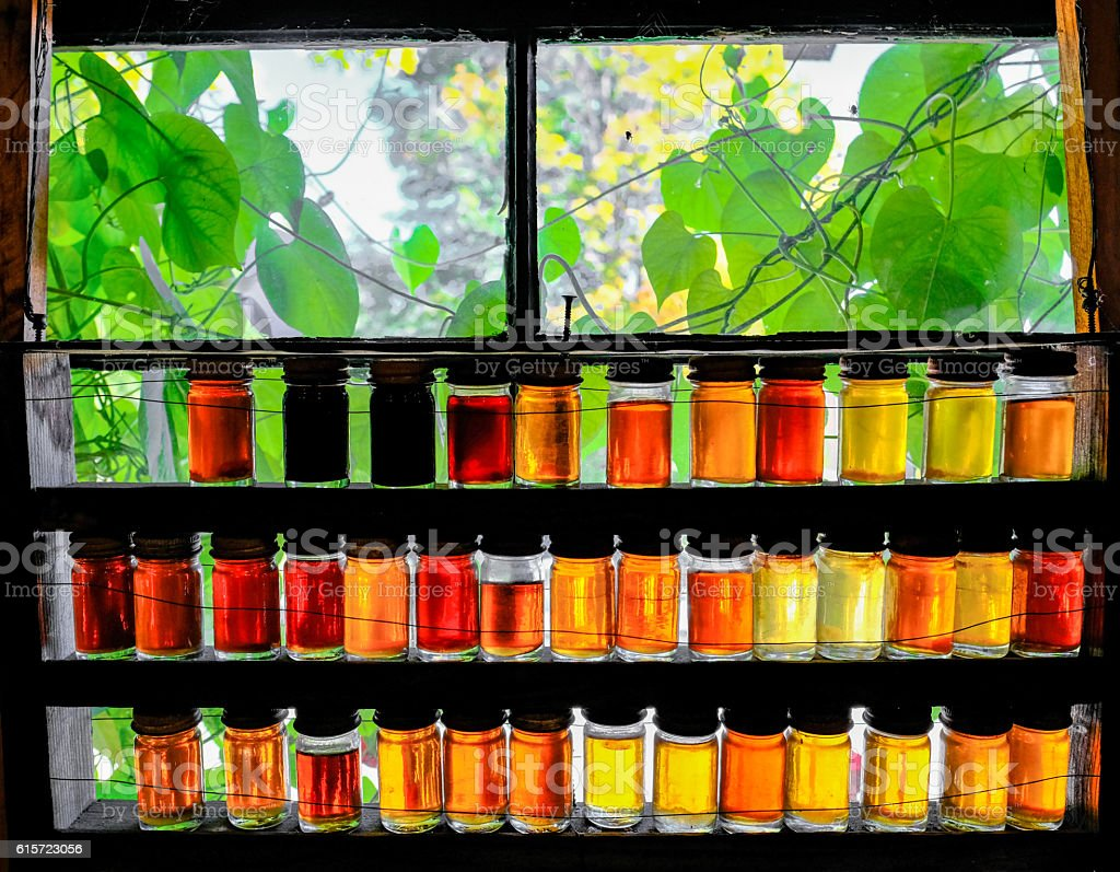 Colourful Maple Syrup Jars On A Window Sill stock photo