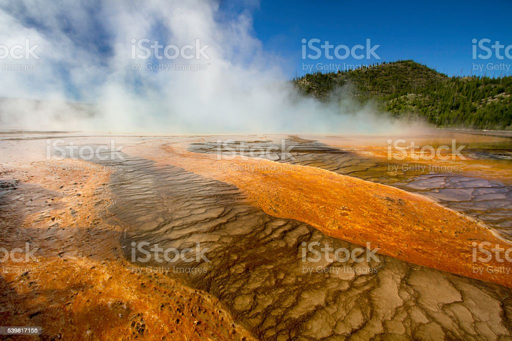 Colourful minerals and steam on geyser surface stock photo