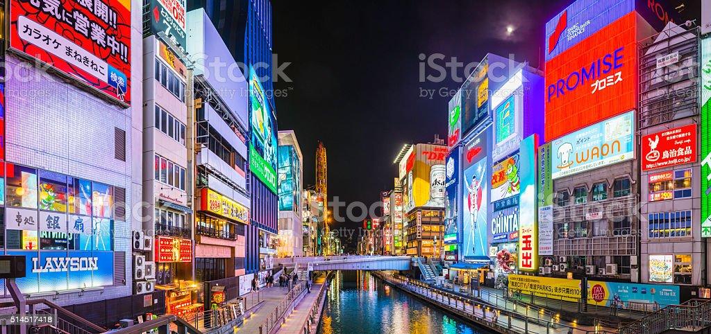 Colourful neon billboards illuminating iconic Dotonbori canal panorama Osaka Japan stock photo