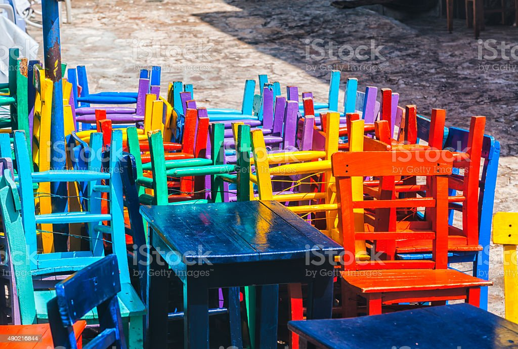 Colourful Painted Wooden Chairs stock photo