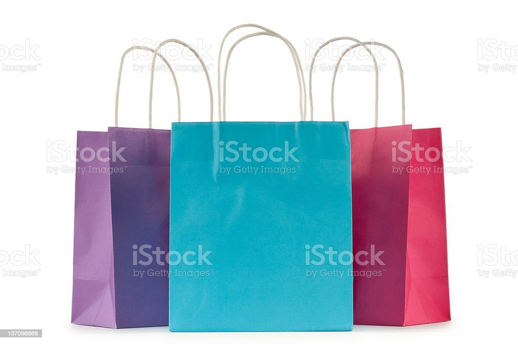 Colourful paper shopping bags isolated on white royalty-free stock photo