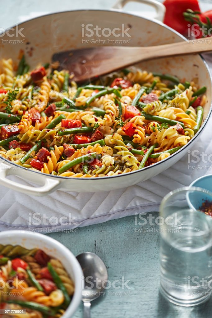 Colourful pasta with chorizo and vegetables stock photo