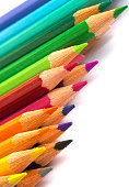 Colourful pencils on a white surface.Close up