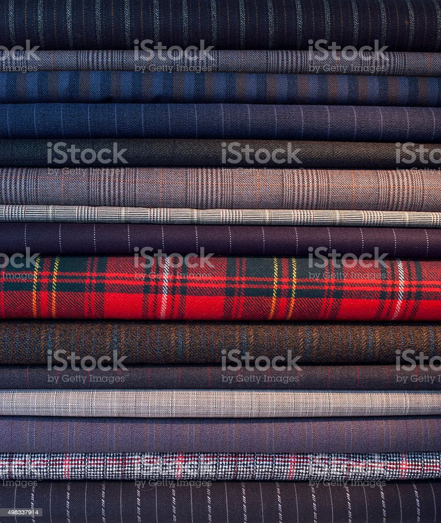 Colourful pile of pin striped suit  fabrics stock photo
