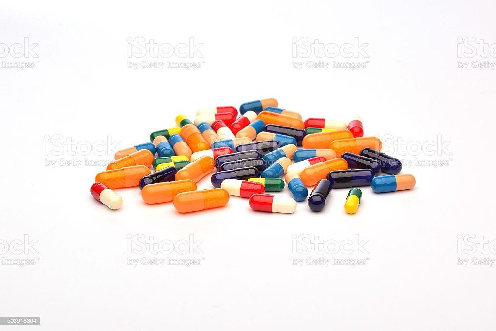 Colourful pills on white background stock photo