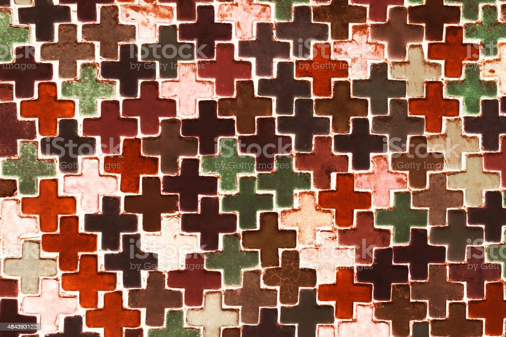Colourful plus shape. Tile wall. royalty-free stock photo