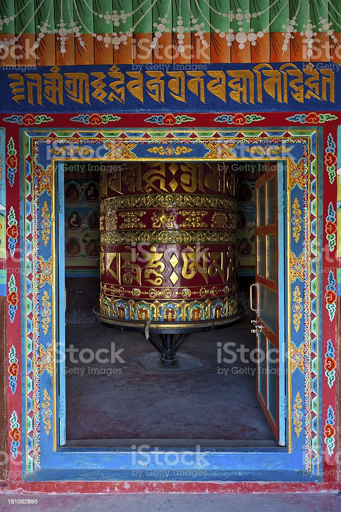 Colourful prayer wheel Buddhist shrine Himalayas Nepal royalty-free stock photo