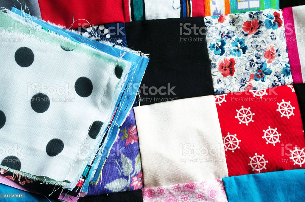 Colourful Quilt and a stack of blocks stock photo