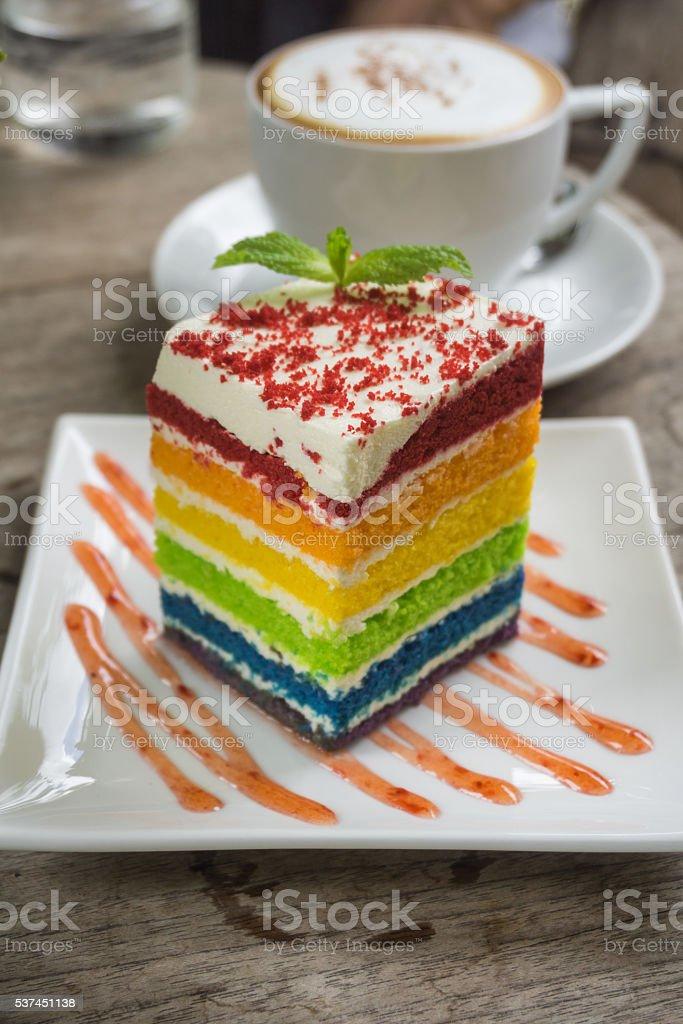 Colourful Rainbow Sponge Cake and Coffee stock photo