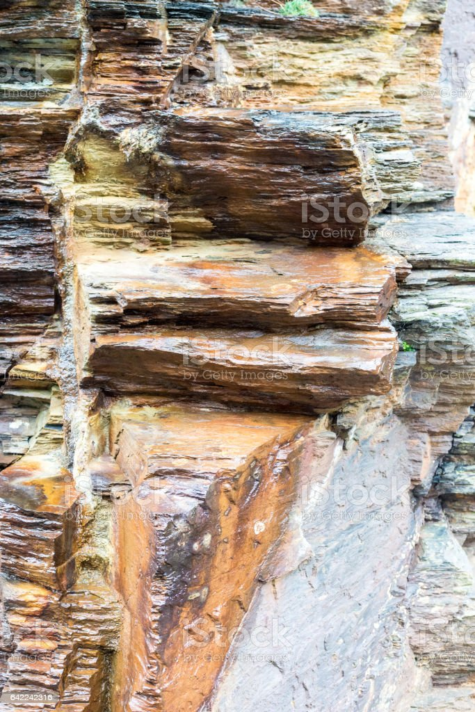 Colourful rock stained with tin stock photo