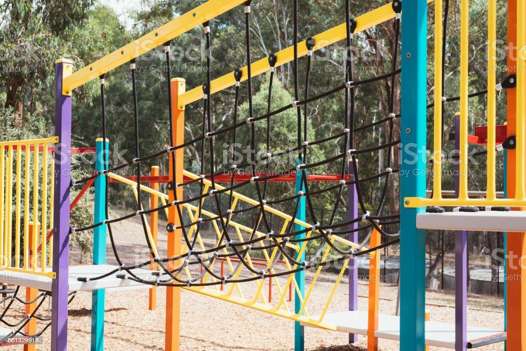 Colourful rope bridge in childrens playground. stock photo